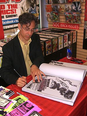 Born Again (comics) - David Mazzucchelli autographing a copy of the Artist's Edition of the story at a June 28, 2012 signing at Midtown Comics in Manhattan