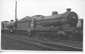John G. Robinson - A Robinson-designed GCR Class 8K 2-8-0 heavy freight locomotive, built in 1912, in service at Langwith Junction shed on 7 August 1960