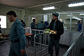 ANP cadets carrying food trays inside the dining area of a training center.jpg