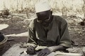 ASC Leiden - Coutinho Collection - C 19 - Life in Sara, Guinea-Bissau - Imam writing - 1974.tif