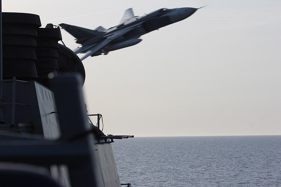 A Russian Sukhoi Su-24 makes a very-low altitude pass by the USS Donald Cook (DDG 75)
