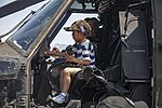 A local child exploring a static display UH-60 in Camp Fuji during Friendship Festival 11 May 2019.jpg