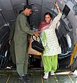 A rescued old woman from Nepal is being de-boarded at Palam Airport from a Transport Aircraft by Indian Air Force officials on April 28, 2015.jpg