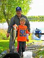 A young alaskan and his grandfather went out for a day of fishing.jpg