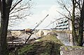 Aanleg Olympiapad brug en Steesloot fietstunnel, rechts Willem Blaeu school, achtergrond voetbalclub - RAA-DMGA-02056 - RAA Elsinga.jpg