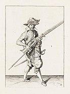 Aanwijzing 13 voor het hanteren van het musket - V Musquet afneemt ende neffens u furquet draecht (Jacob de Gheyn, 1607)