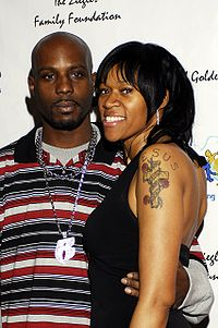 Academy Awards afterparty CUN DMX and woman.jpg