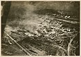 Aerial view of a burning munitions factory (9414753985).jpg