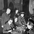 Air Marshal Sir Arthur Harris (left) observes as Wing Commander Guy Gibson's crew is debriefed after No. 617 Squadron's raid on the Ruhr Dams, 17 May 1943. CH9683.jpg