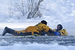 Airman 1st Class Joseph Humphrey and Airman 1st Class Tyler Parmelee conduct ice water rescue training (32666816982).jpg