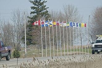 Veterans Memorial Parkway - Flagpoles along the southbound lanes of Veterans Memorial Parkway near the Highway 401 interchange.