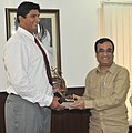 Ajay Maken presenting the Arjuna Award for the year 2011 to Shri Vikas Gowda, the award was conferred by the President of India, in New Delhi on September 06, 2011.jpg