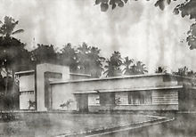 A black-and-white photograph of a studio building