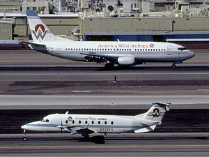 America West Airlines - America West Boeing 737-300 and America West Express Beechcraft 1900D at Sky Harbor International Airport (1995)