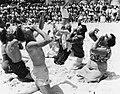 American golfers doing the Hokey Pokey on a sandy beach, Coolangatta, Gold Coast, 1953 (5850863958).jpg