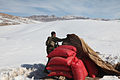 An Afghan National Army commando searches for illegal fertilizer used in making improvised explosive devices in Khakrez district, Kandahar, Afghanistan, Jan 26, 2012 120126-A-NC985-385.jpg