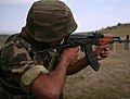 An Azerbaijani Land Forces (ALF) soldier with the Operational Capabilities and Concepts Battalion fires an AKS-74 rifle at the marksmanship training range in the Babadag Training Area in Romania 110804-M-OB762-005.jpg