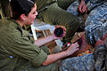An Israeli soldier, left, applies makeup to simulate wounds on a U.S. Soldier for his role in a medical exercise for Austere Challenge 2012 in Beit Ezra, Israel 121022-F-QW942-025.jpg