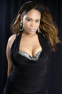 Angelique Monét wearing black dress.jpg