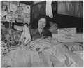 Anna Samet is one of hundreds of tenants of New York's East Side market places who are cooperating with their... - NARA - 195458.tif