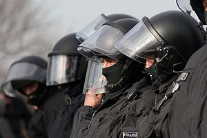 Inequality in Germany - Police wear protective riot gear during anti-Nazi demonstration