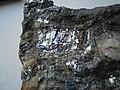 Antimonite (Sb2S3) (25837843610).jpg