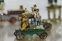 Antique German tin toy boy hunting with dog (26129306245).jpg