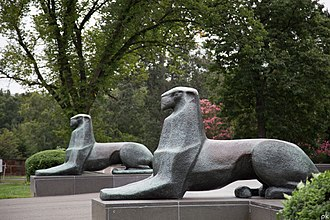Netherlands Carillon - Bronze lions overlooking part of the field of tulips