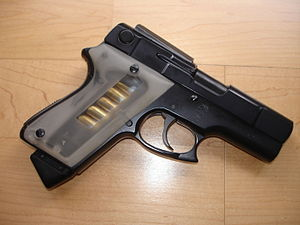 ASP pistol - ASP handgun (notice clear rubber hand grips for keeping count of ammunition in magazine) .