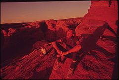Backpackers Terry Mcgaw and Glen Denny Rest in the Setting Sun at the End of the Trail to Delicate Arch, 05-1972 (3814165693).jpg