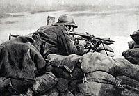 Belgian machinegunner in 1918 guarding trench