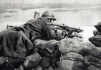 Chauchat - A Belgian machine gunner armed with a Chauchat, guarding a trench