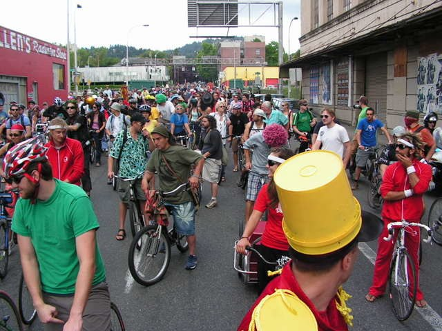 Many bicyclists with colorful clothes