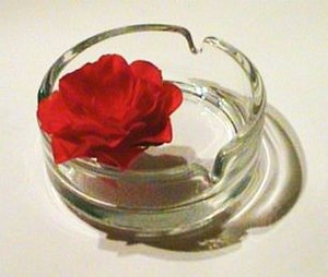 An ashtray with a rose, Logo of the World No T...