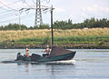Boating boat during summer on spui near Hekelingen Holland.jpg