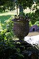Bridge pan satyr urn Pleasure Grounds, Parham House, West Sussex, England.jpg