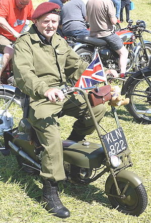 Corgi Motorcycle Co Ltd. - British Paratrooper re-enactor wearing a Parachute Regiment beret on a Corgi mini motorcycle in 2010