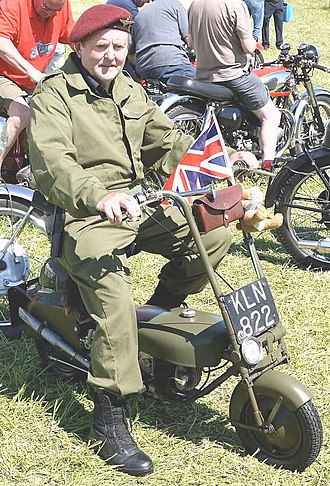 Corgi Motorcycle Co Ltd. - British Paratrooper re-enactor wearing a Parachute Regiment beret on a Corgi mini motorcycle in 2010