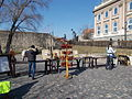 Budapest Castle district. Royal Palace 'A' Wing, National Gallery, North end wall, the Gate of Corvinus with a raven. Archery, spear throwing..JPG