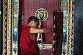 Buddhist monk making 'ghost catcher', India (8083311844).jpg