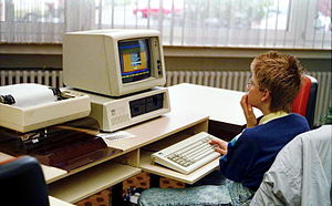 IBM Personal Computer - IBM Personal Computer with IBM CGA monitor (model number 5153), IBM PC keyboard, IBM 5152 printer and paper stand. (1988)