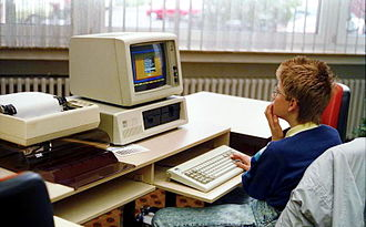 IBM Personal Computer - IBM Personal Computer with IBM CGA monitor (model 5153), IBM PC keyboard, IBM 5152 printer and paper stand. (1988)