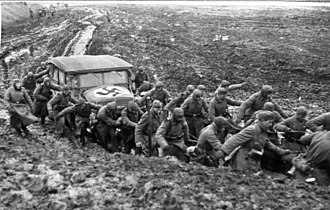 Eastern Front (World War II) - Wehrmacht soldiers pulling a car from the mud during the rasputitsa period, November 1941