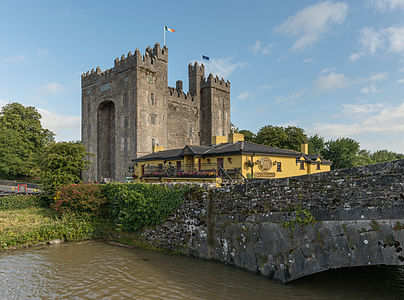 A southeast view of Bunratty Castle and the nearby Durty Nelly's pub