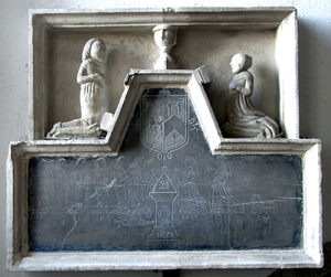 South Tawton - The Burgoyne Monument in St Andrew's Church South Tawton. This slate and stone tablet on the wall of the South Chapel is dated 1651 and is in memory of Robert Burgoyne, his wife and their family. Those who are commemorated include a child in a cradle and an infant in a shroud. The arms of Burgoyne are: Azure, a talbot argent (As shown on the monument to Thomas Chafe (d.1648) in the church at St Giles in the Wood, Devon, who married a Burgoyne