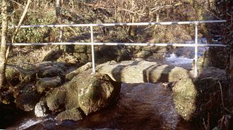 Guard rail - A handrail leading along a rocky creek crossing