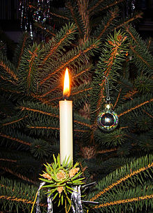 a candle on a christmas tree