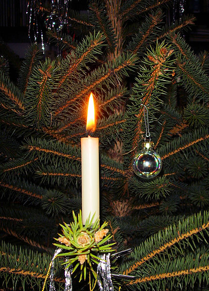 Candle on a decorated Christmas tree. image c. Gerbil.