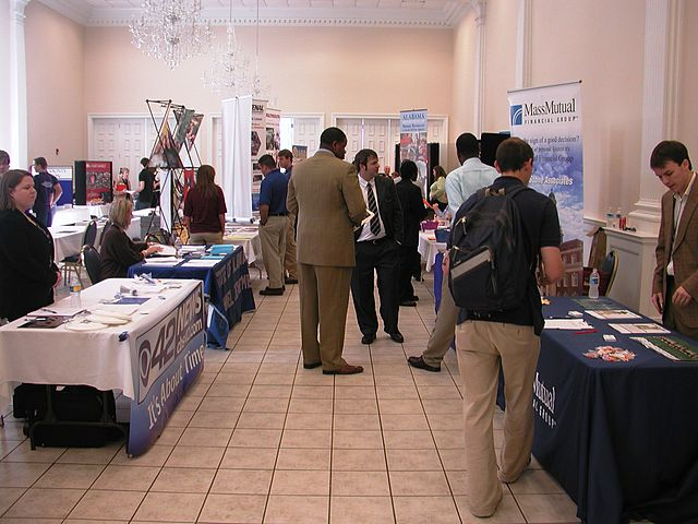 Career Fair By carmichaellibrary (Career Fair  Uploaded by AlbertHerring) [CC-BY-2.0 (https://creativecommons.org/licenses/by/2.0)], via Wikimedia Commons