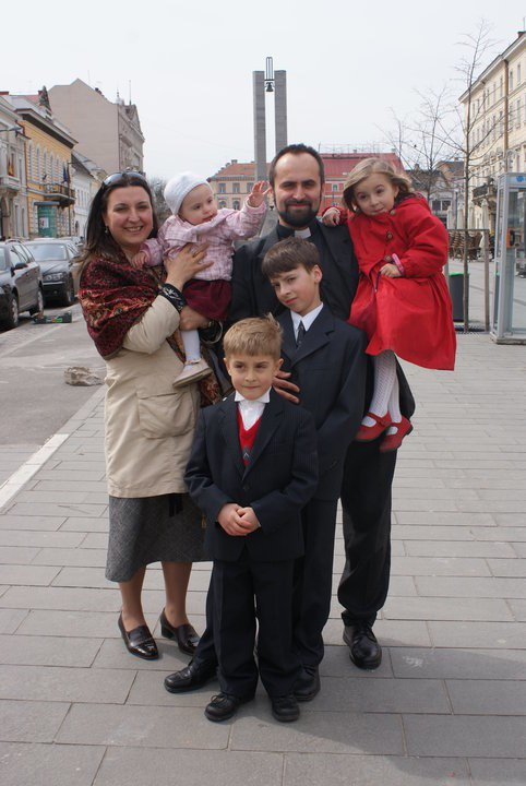 Catholic priest with his Family